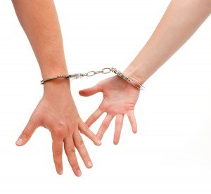 handcuffed couple