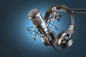 Headphones on microphone stand, professional studio