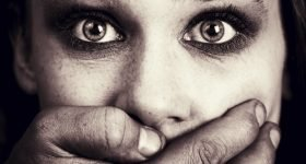 Scared woman victim of domestic torture and abuse