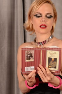 Woman in pink handcuffs reads book