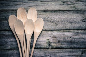 Wooden spoons on rustic background