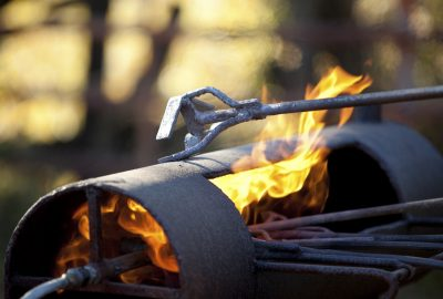 A branding iron and a lit flame