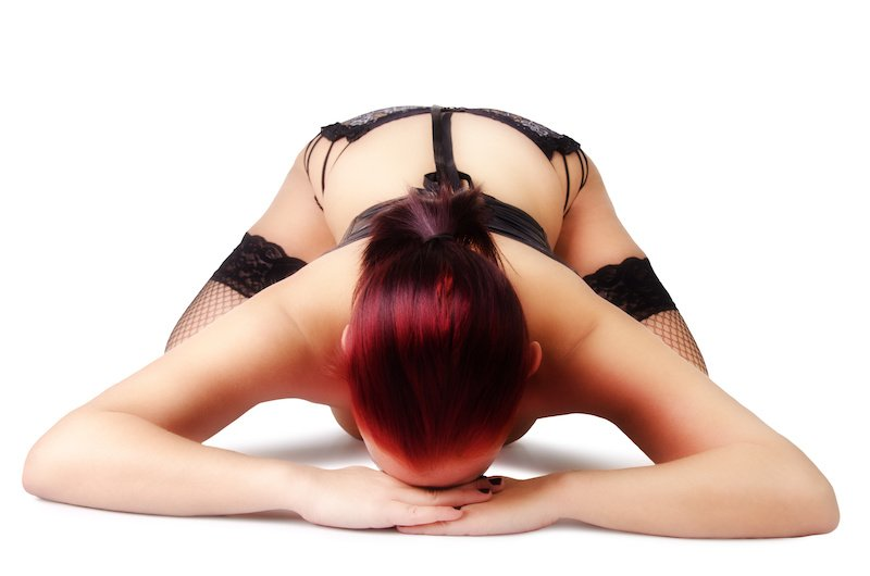 Submit slave position - female slave kneeling forward face down with knees spread