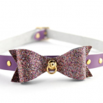 Purple glitter bow collar form Restrained Grace