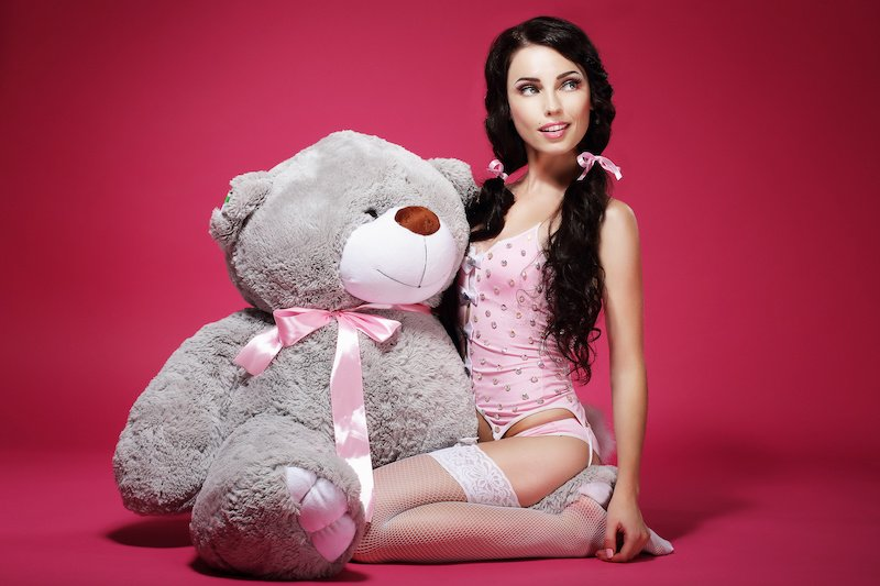 big little cute woman with pigtails and teddy bear