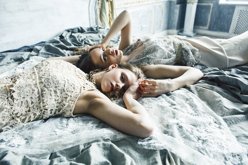 two beautiful slave girls lying in bed awaiting their master