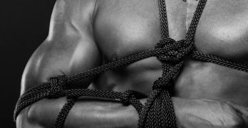 sexy, muscular male submissive bound
