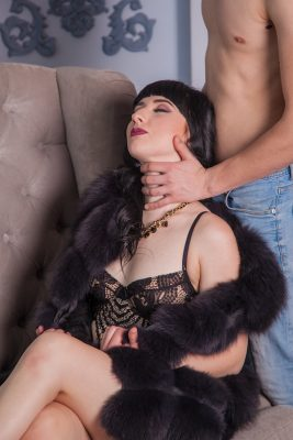 choke neck squeeze of submissive woman by dom
