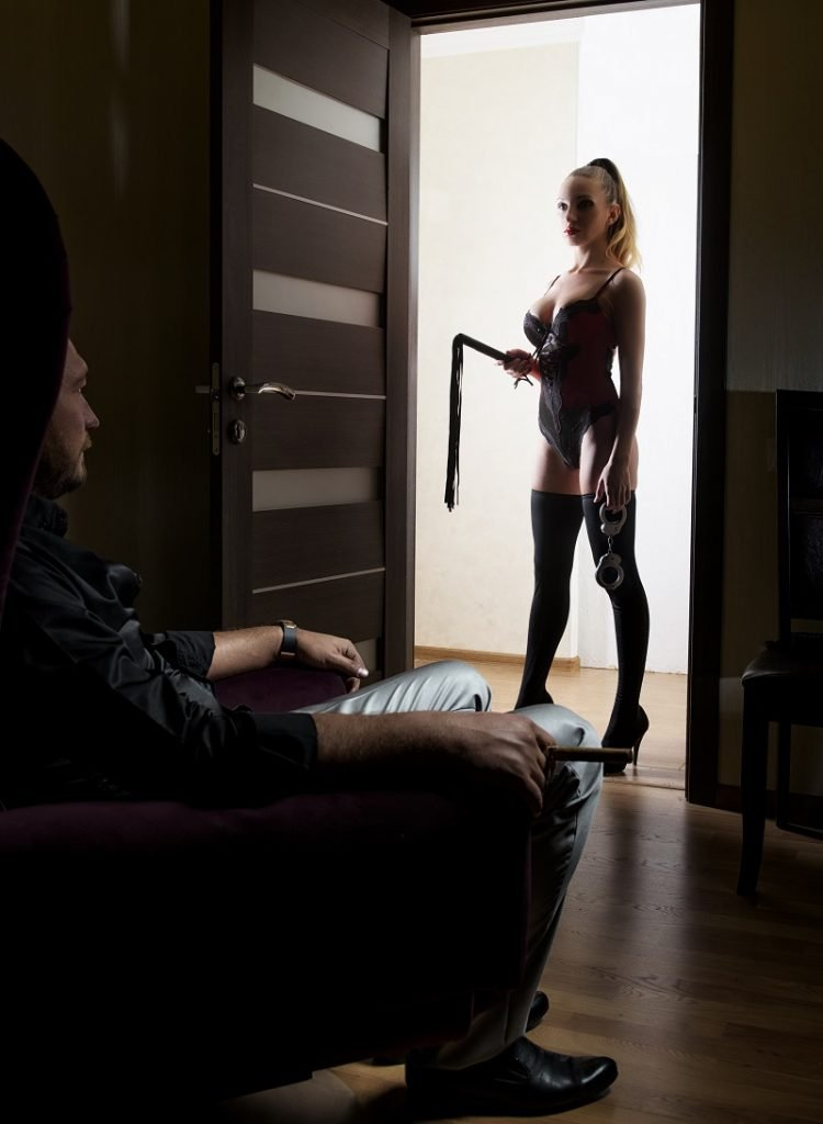 hot sexy Domme with whip, male submissive