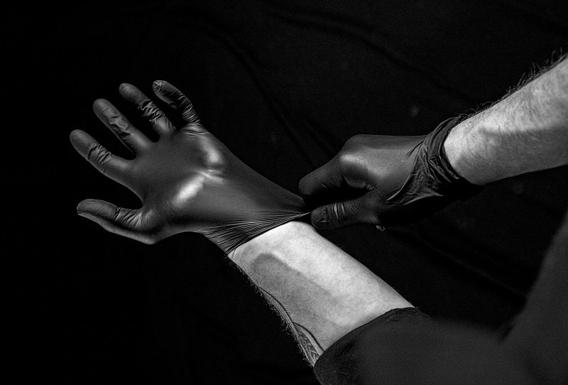 male dominant with latex gloves