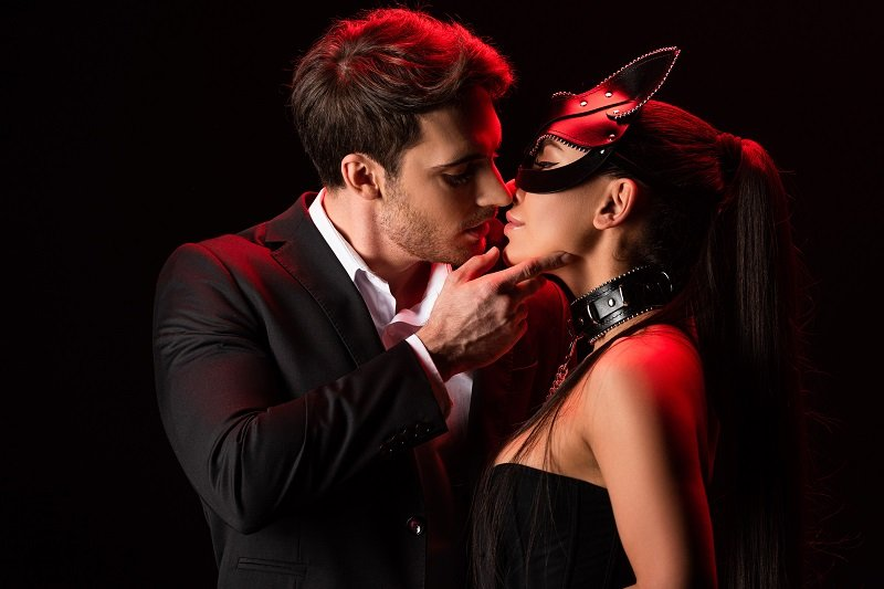 hot couple kissing, kitten mask