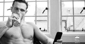 hot shirtless man sexting on his phone