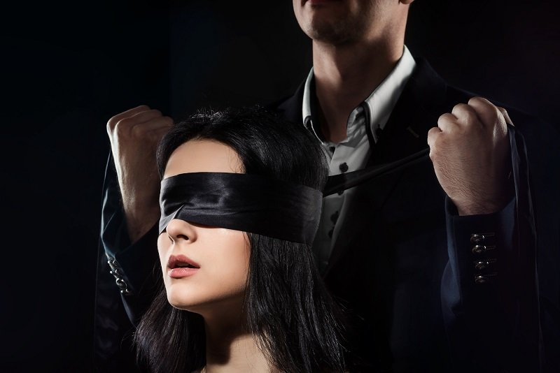sexy female submissive getting blindfolded