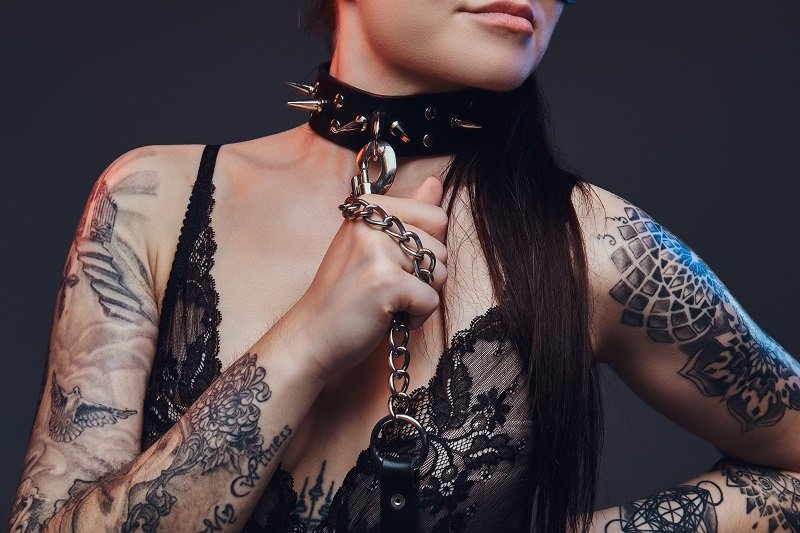 sexy tatted vixen with collar