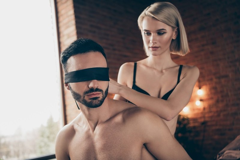 sexy power exchange couple, submissive blindfolded