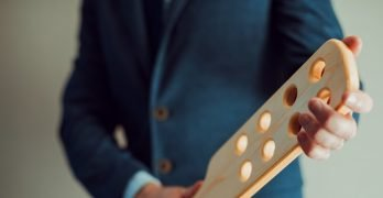 sexy male Dominant with wooden paddle