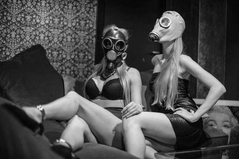 two sexy submissives in gas masks