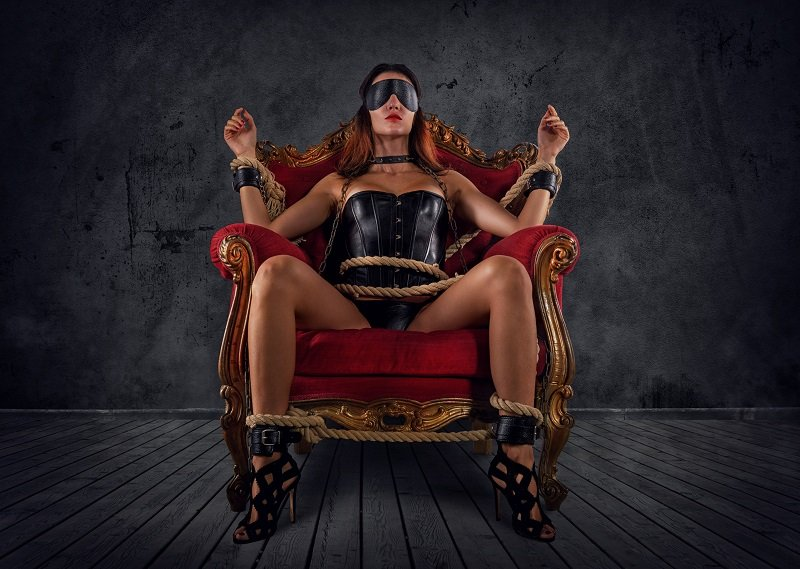 how sub woman in chains and leather