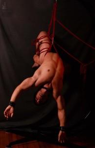 man hanging upside down